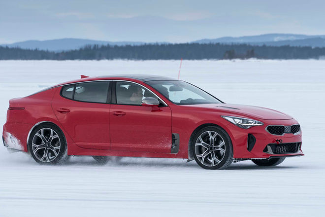 2018-Kia-Stinger-winter-drive-front-three-quarter-in-motion